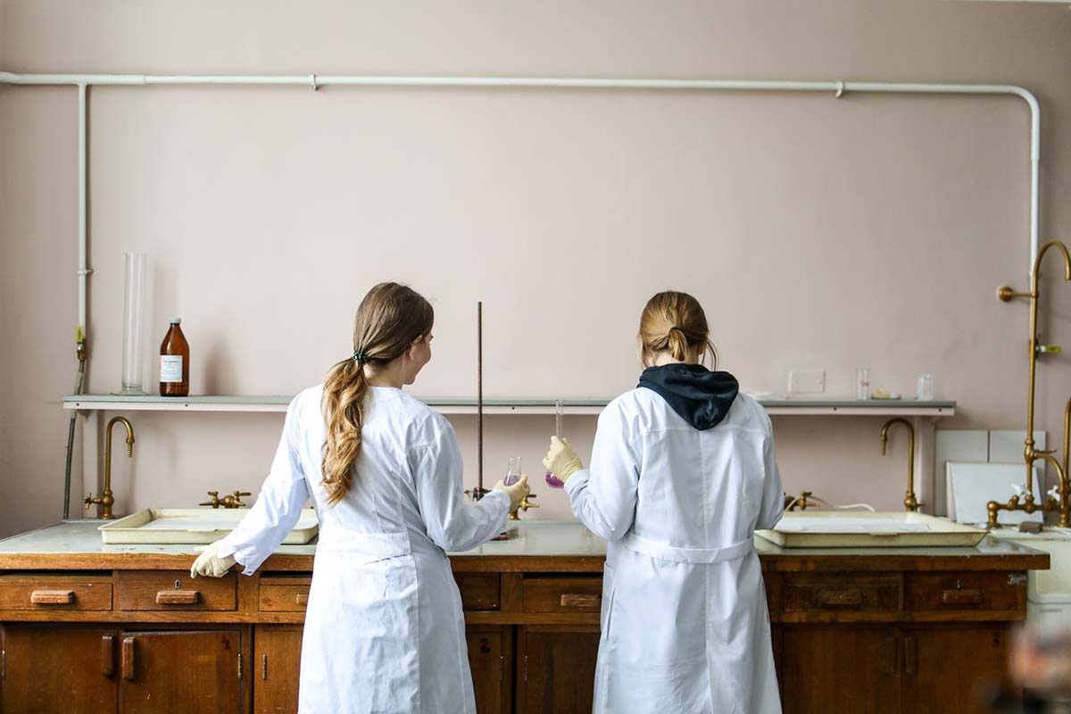 women-in-white-laboratory-gown-standing-ver
