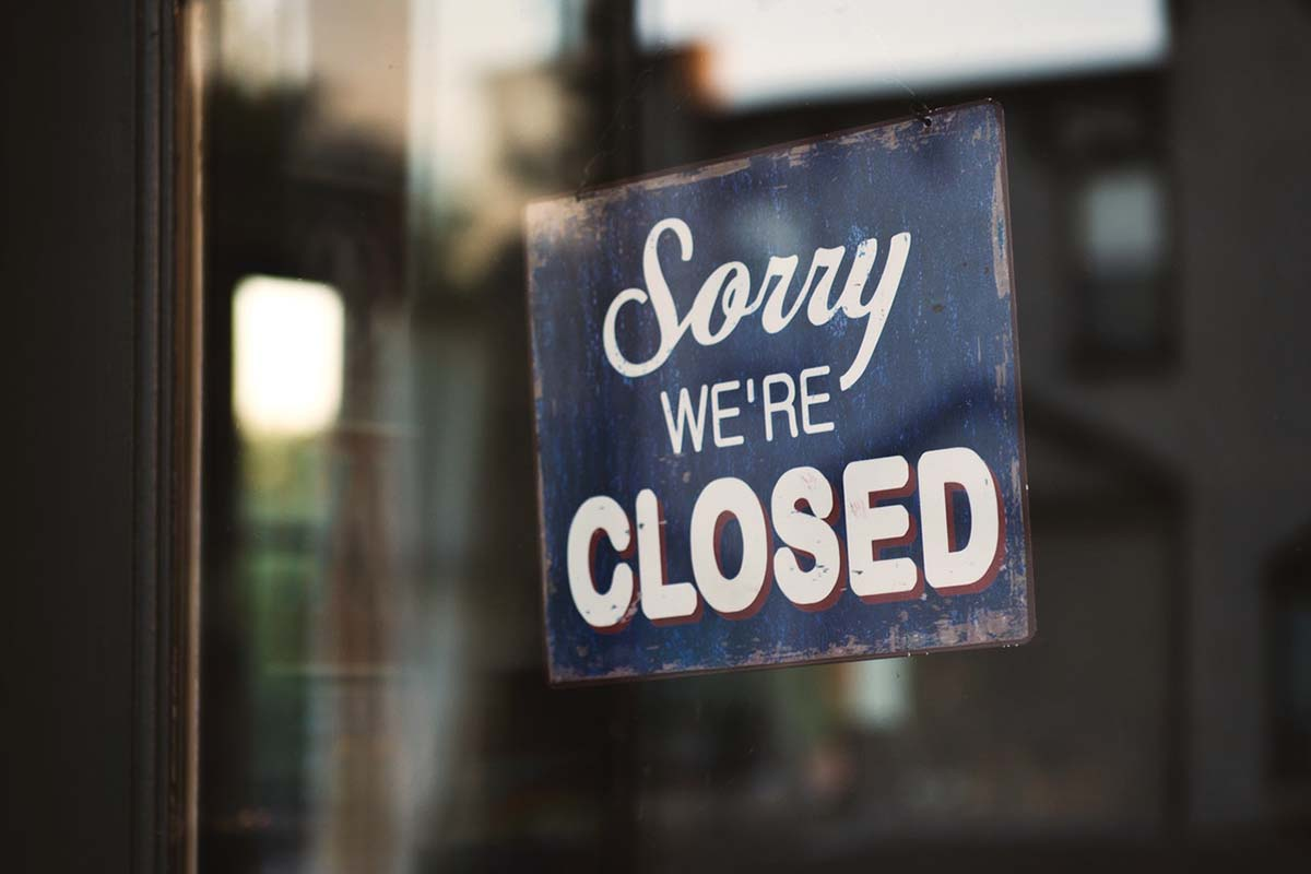 blue-and-white-sorry-we-re-closed-wooden-signage